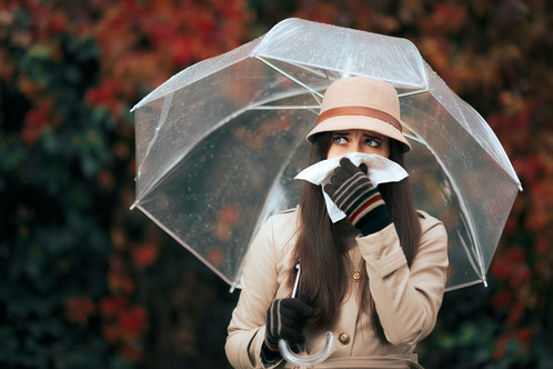 Woman Flu Umbrella Raining On Istock By Nicoletaionescu